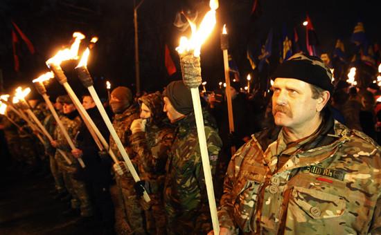 Участники марша в честь 106-й годовщины со дня рождения Степана Бандеры. Киев 2 января 2015 года