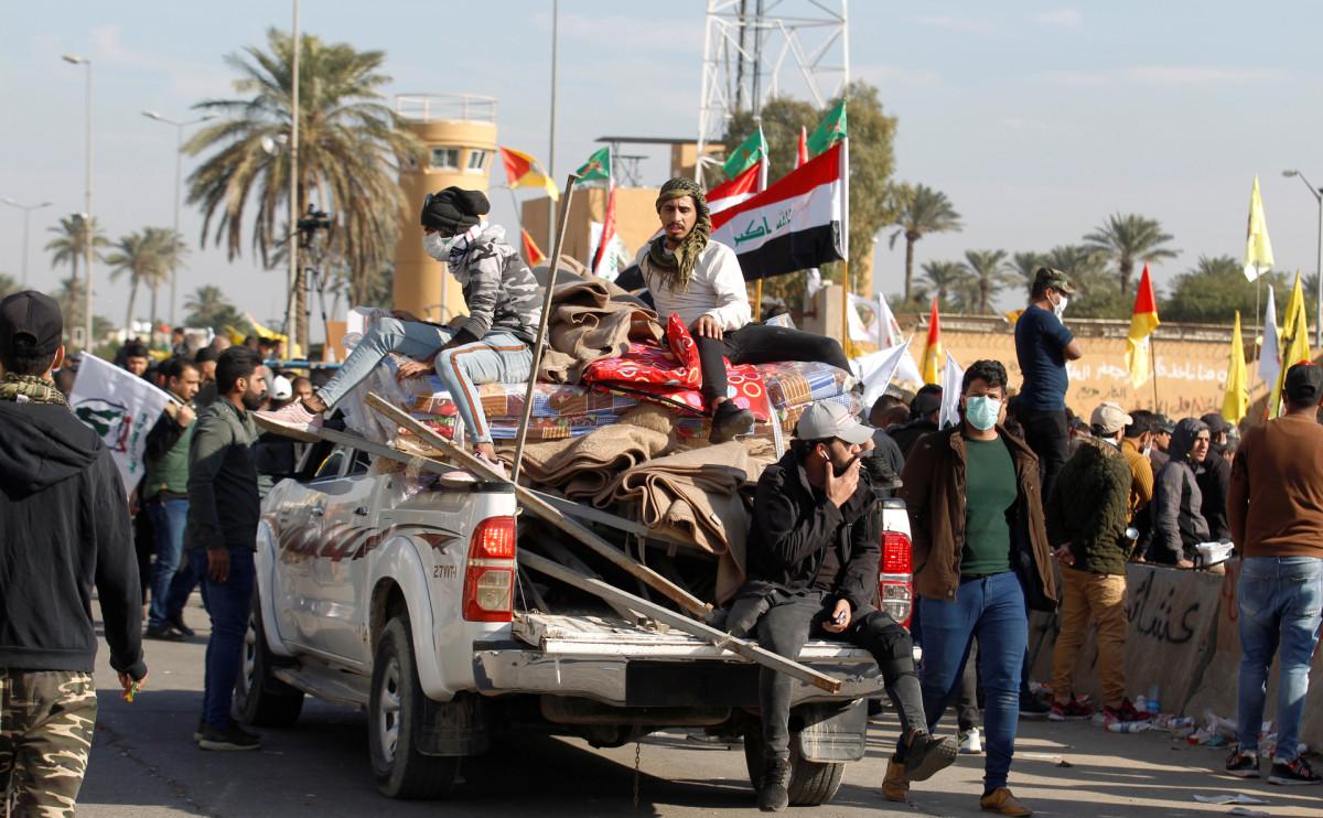 Протестующие и участники ополчения в Ираке