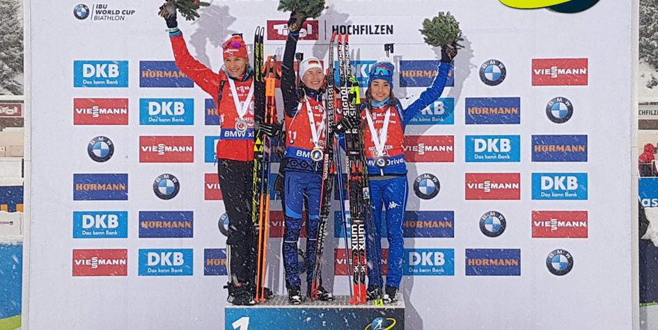 Призеры спринтерской гонки на этапе Кубка мира в Хохфильцене Анастасия Кузьмина, Дарья Домрачева и Доротея Вирер (слева направо)