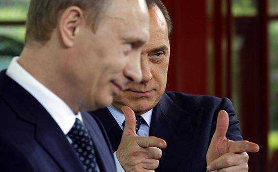 Президент России Владимир Путин ибывший премьер-министр Италии Сильвио Берлускони.Архивное фото