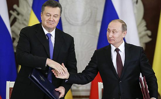 МВФ не сможет давать кредиты Украине, пока та не решит вопрос с евробондами, купленными Россией (справа — президент Владимир Путин) у правительства Виктора Януковича (слева)