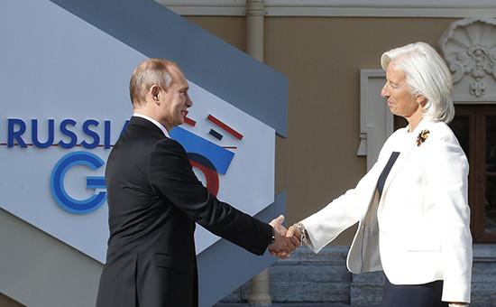 Президент России Владимир Путин иглава МВФ Кристин Лагард