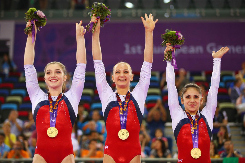 Российские гимнастки Алия Мустафина, Виктория Комова и Седа Тутхалян на Европейских играх в Баку, 2015