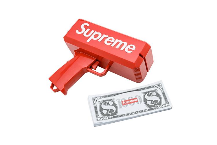 Деньгомет и банкнотыс логотипом Supreme