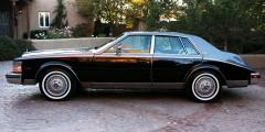 Cadillac Seville На одной из самых известных фотографий певца изображен Cadillac Seville начала 1980-х. Снимок сделан в 1990-х в России, а машина, судя по номерам, принадлежит иностранцу.