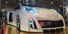 Hyper Leaf от Obayashi Factory  Nissan Leaf от Obayashi Factory как будто примерил обвес не своего размера. Трехдверный кузов с гигантскими воздуховодами, жидкокристаллические экраны в переднем бампере и подъемная крыша с множеством аудиоколонок. Главное, чтобы на все это хватило штатного аккумулятора.