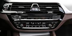 BMW 5-Seriesориентирована на водителя, вот и центральная консоль развернута к нему