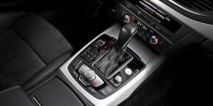 Кнопка запуска двигателя в A7 расположена рядом с органами управления мультимединой системой MMI.