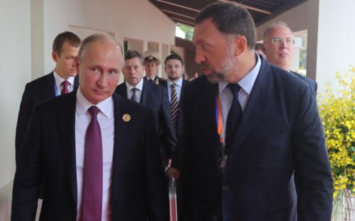 Владимир Путин и Олег Дерипаска на саммите АТЭС во Вьетнаме