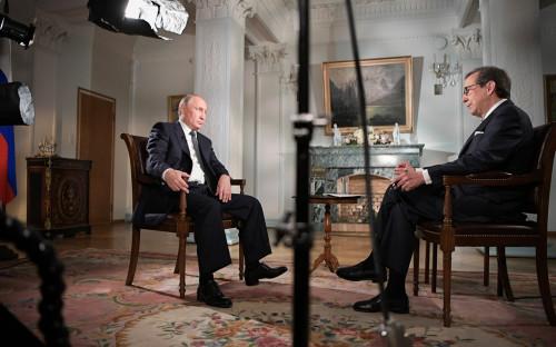 Владимир Путин и ведущий телеканала Fox News Крис Уоллес