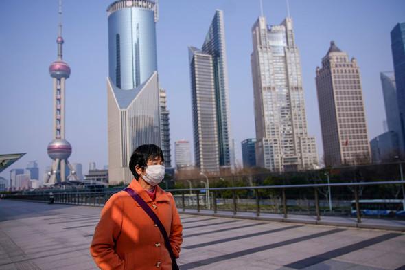 Улицы городов Китая опустели из-за коронавируса. Фоторепортаж ...