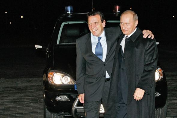 Владимир Путин и канцлер Германии Герхард Шрёдер (слева)