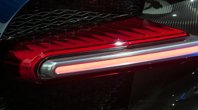 Над обликом этого автомобиля, в том числе необычными задними фонарями, поработал российский дизайнер. И потом был приглашен работать в другой, набирающий обороты автомобильный бренд. Какой автомобиль на снимке?