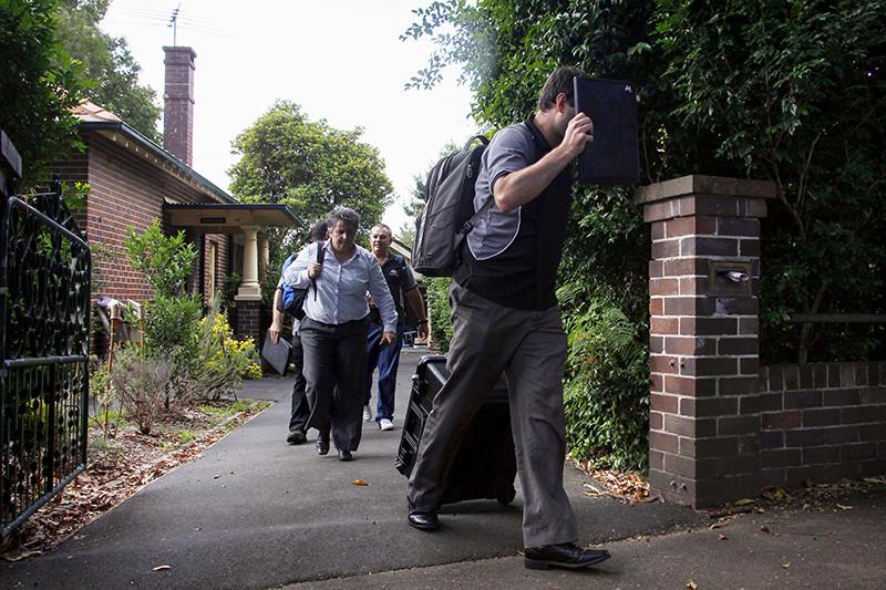 Австралийские полицейские вовремя обысков вдоме Крейга Райта