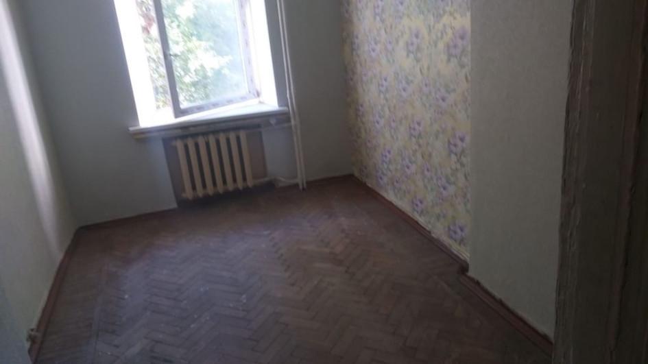 Квартира расположена на улице Заморенова, в семи минутах ходьбы от станции метро «Краснопресненская». Площадь— 12,8 кв. м