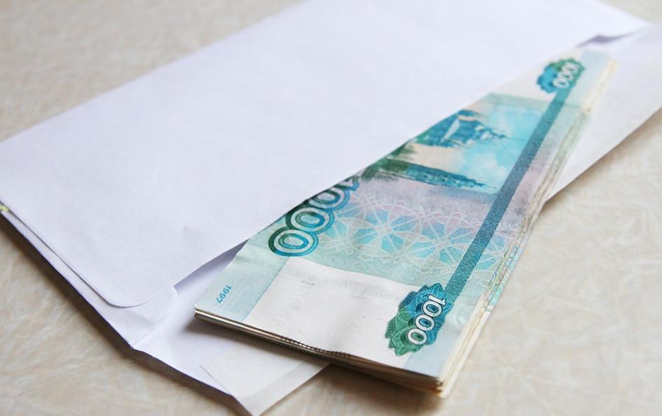 Работник, получающий «конвертную» зарплату, рискует штрафом и даже лишением свободы сроком до года