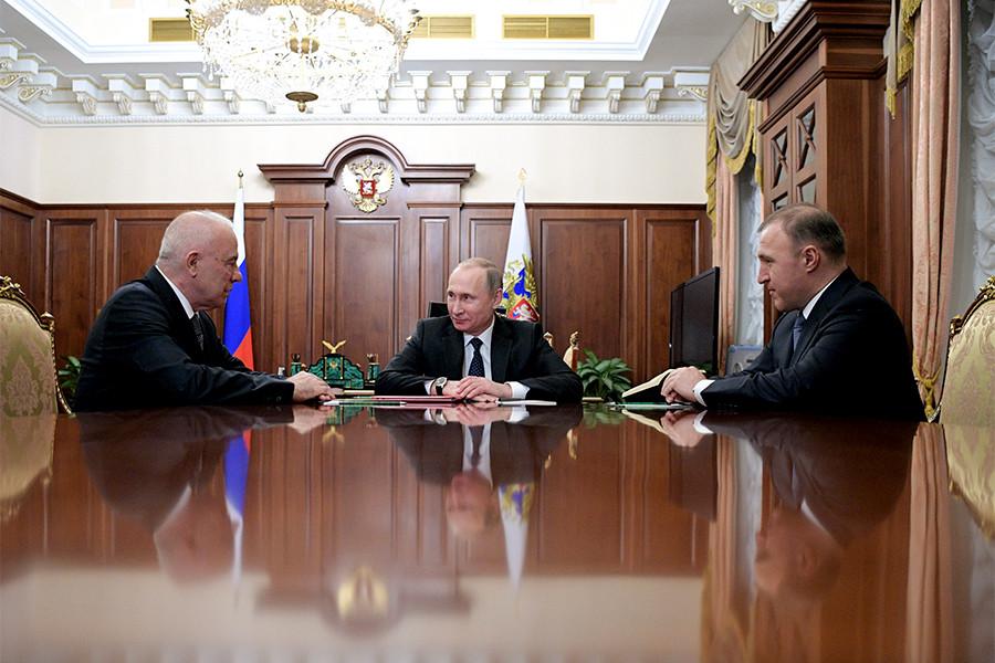Аслан Тхакушинов, Владимир Путин и Мурат Кумпилов (слева направо) во время встречи в Кремле