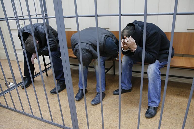 Темирлан Эскерханов, Шадид Губашев и ХамзатБахаев назаседании Басманного суда Москвы, 8 марта 2015 года