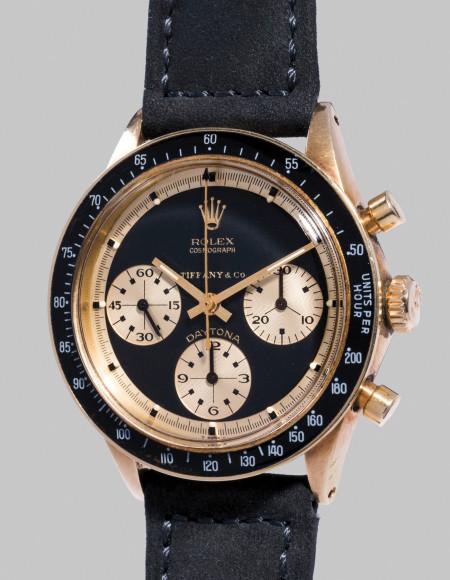 """Rolex Ref. 6241 Cosmograph Daytona """"John Player Special Paul Newman"""" Редкий и уникальный наручный хронограф Rolex в желтом золоте, проданный Tiffany & Co. Оценочная стоимость: CHF 400–800 тыс."""