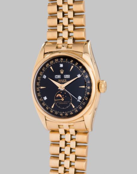Rolex Ref. 6062 Bao Dai Исторически значимые наручные часы. Желтое золото с черным циферблатом и алмазными индексами, с календарем и индикатором фаз Луны.