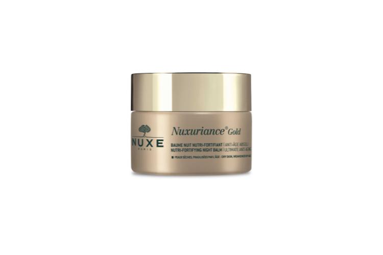 Питательный укрепляющий антивозрастной ночной бальзам для лица Nuxuriance Gold, Nuxe разглаживает, смягчает, питает и придает упругость коже, стирает признаки усталости. В составе масло ши и трикомплекса: Bi-Floral, полученный из клеток шафрана и бугенвиллеи, Oleoactif из фарфоровой розы с шестью активными молекулами, а такжеантивозрастной питательно-восстанавливающий с экстрактом гиностеммы пятилистной и ладанника