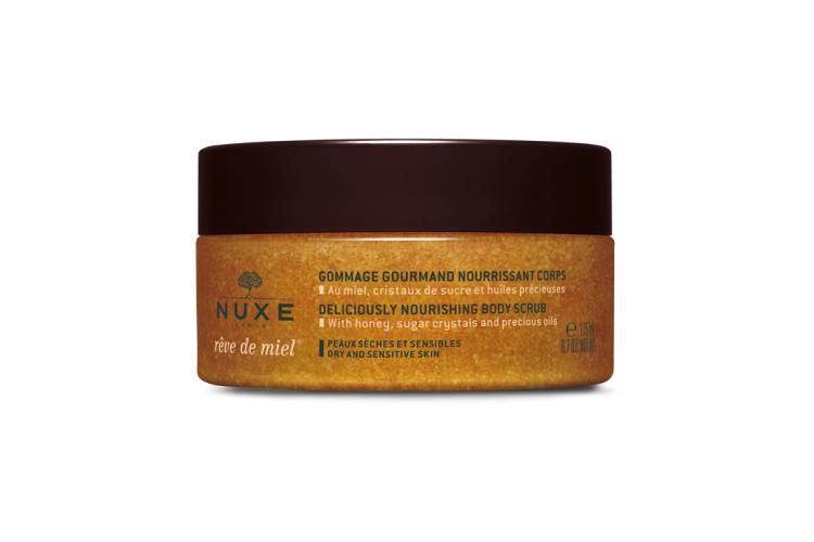 Нежный питательный скраб для тела Rêve de miel nourishing body scrub, Nuxe включает в себя кристаллы сахара, мед и растительные масла подсолнечника, арганы и огуречника, масло ши ирисовый порошок