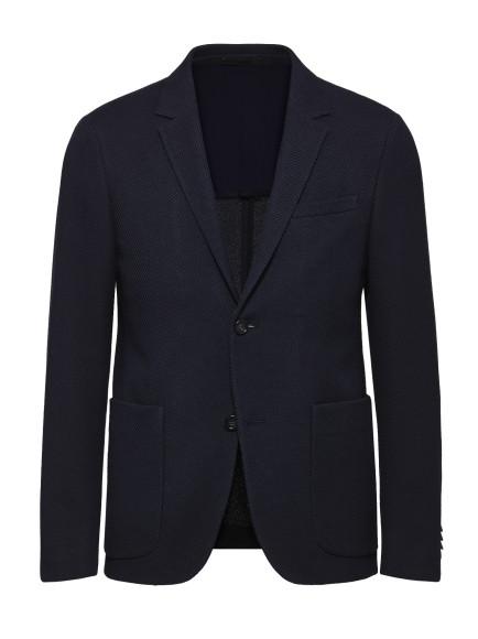 Блейзер, Z Zegna. Легкий хлопчатобумажной пиджак с половинной подкладкой окажется незаменимым в последние теплые месяцы года и точно не выйдет из моды ближайшие сезоны.