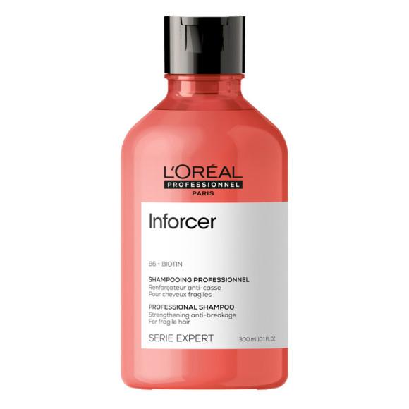 Шампунь для предотвращения ломкости волос Inforcer Shampoo, Serie Expert, L'Oreal Professionnel направлен на борьбу с последствиями от воздействия высоких температур, стайлинга и различных аксессуаров. Формула содержит витамин B6 и биотин, которые преображают волосы, придают им плотность и блеск, а также снижают ломкость и укрепляют структуру по всей длине